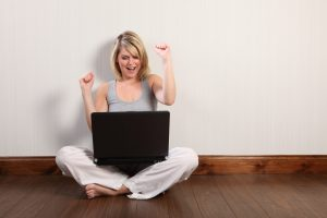 stockfresh_1305090_excited-young-girl-surfing-internet-on-laptop_sizeXXL
