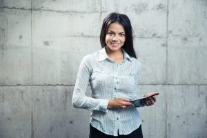stockfresh_5805001_smiling-businesswoman-with-tablet-computer_sizeXXL